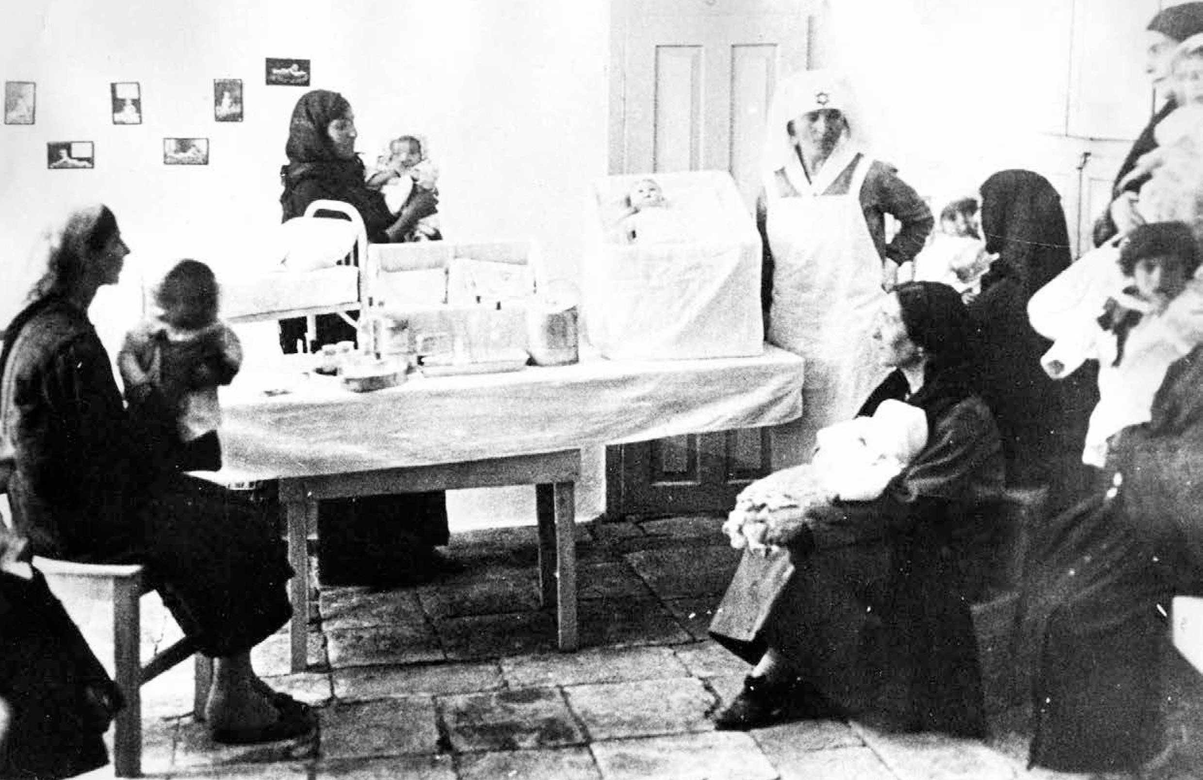 Learning about baby care in a Tipat Halav station in 1927. Courtesy of the Jewish National Fund.