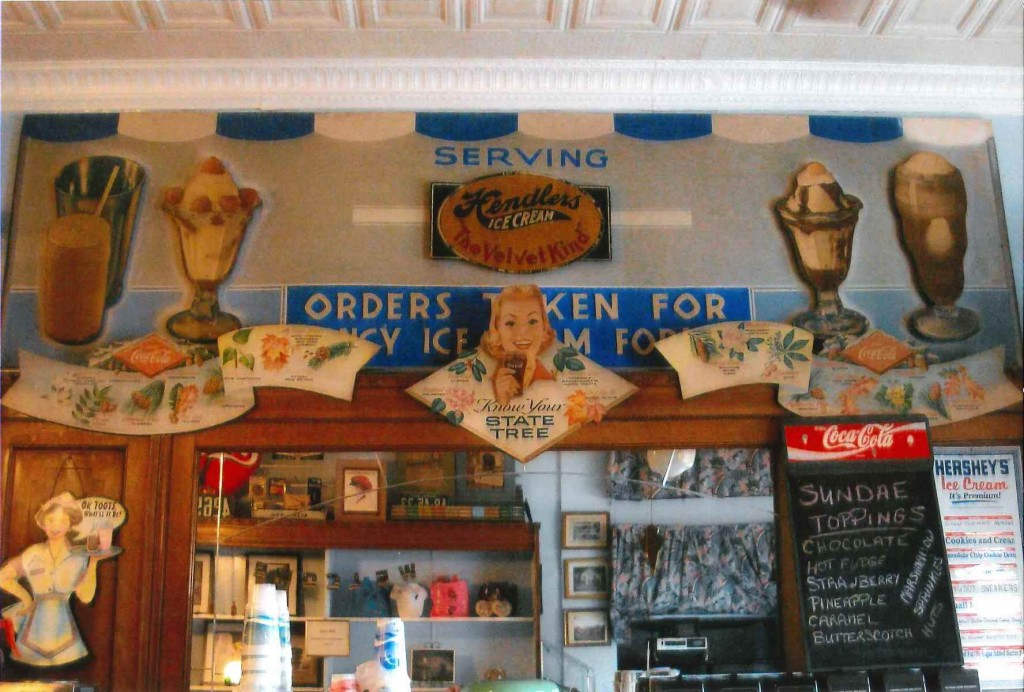 A view of the sign installed above the fountain in Ye Olde Malt Shop, circa 2000. Courtesy of Penny George and Mark Trunk.