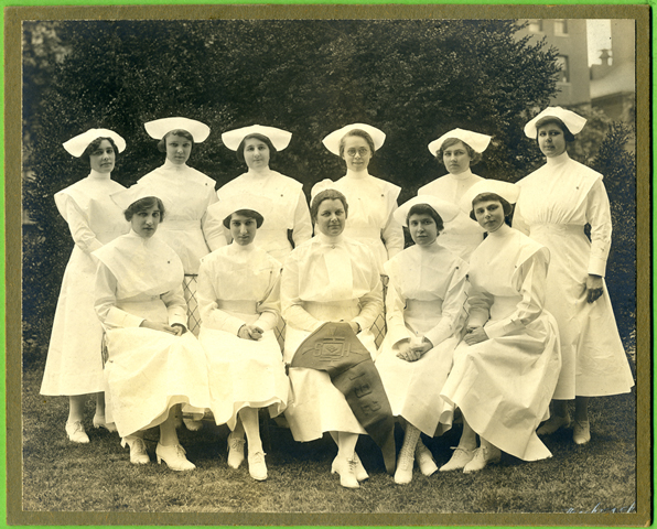 The Hebrew Hospital nurse trainees who entered in 1919 graduated in 1921. Members of the class shown here include: Sara R. Greenfield, Anna E. Fishpaugh, Ellen Holliday (Frazier), Miriam Robider, Gertrude Cohen (Hare), Rhoda May Scarborough (Jenkinson), Bertha Moses (Gomprecht), Anna Klein, Elizabeth Polucki, Helena Williams (Green). Gift of the Sinai Hospital Nurses Alumni Association, JMM. 2010.20.58