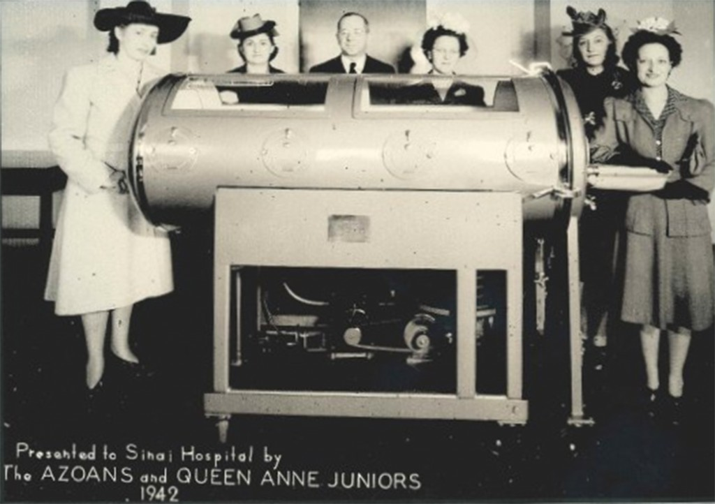 Members of the Azoans (an auxiliary group of the AZO pharmacy fraternity) and the Queen Anne Juniors present an iron lung machine to Sinai Hospital, Baltimore, 1942.  Courtesy of Sinai Hospital of Baltimore and LifeBridge Health.  CP14.2015.21