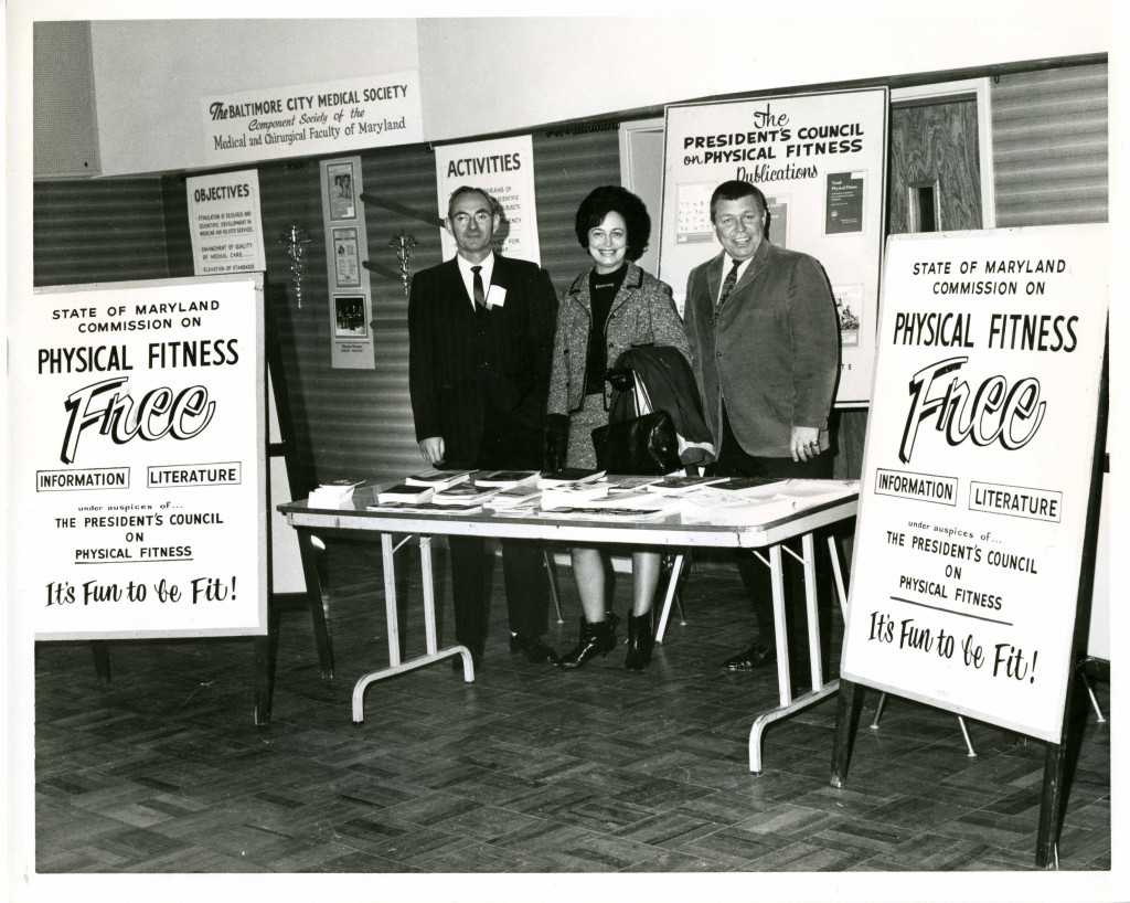 "Members of the State of Maryland Commission on Physical Fitness, ""under the auspices"" of the President's Council on Physical Fitness, distribute literature at the JCC Total Health Fair, circa 1965.  Gift of the Jewish Community Center of Baltimore. JMM 2006.13.1203"