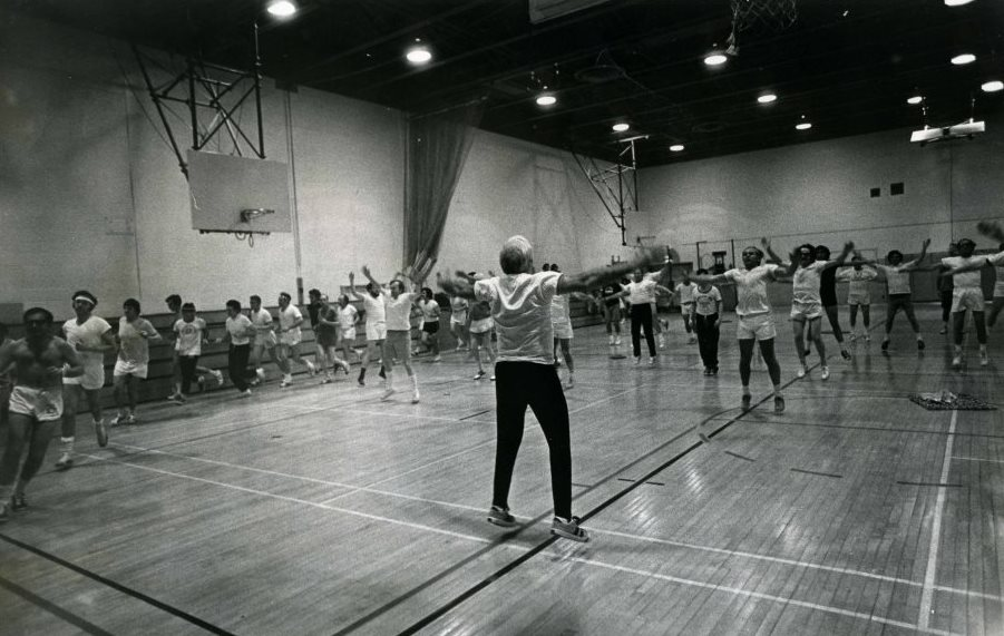 A JCC instructor leads an aerobics class for men while others work on the indoor track, 1974. Gift of the Jewish Community Center of Baltimore. JMM 2006.13.1902