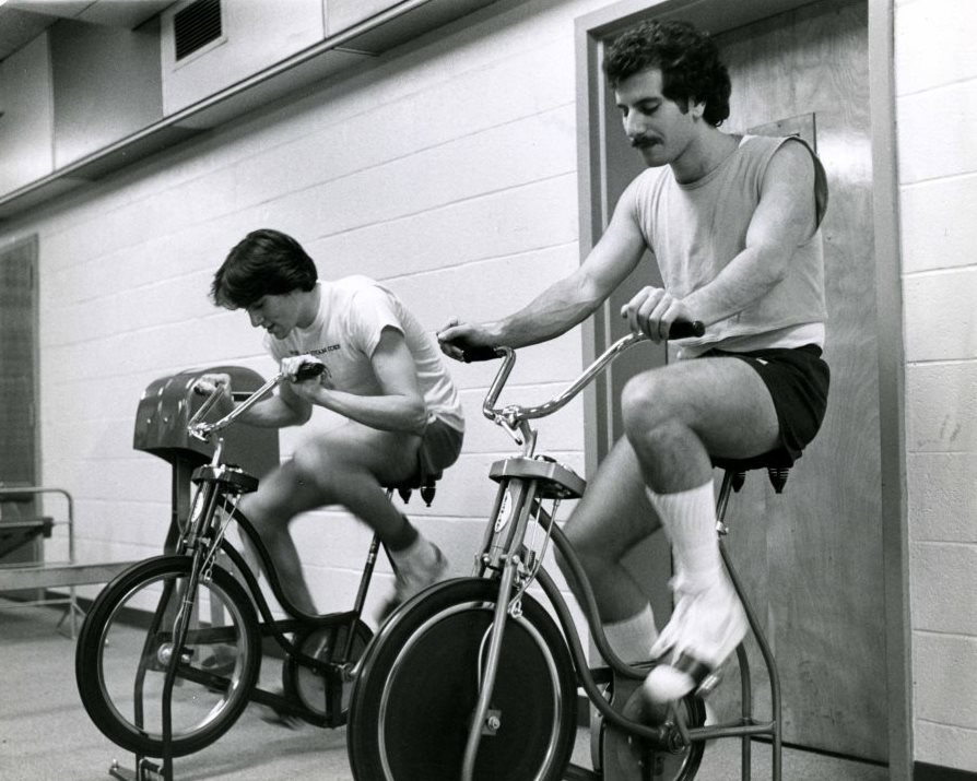 Riding the exercise bikes at the JCC, 1980.  Author's note: I particularly like this photo because I inherited this exact bike model – it's a burnt-orange color – from my parents.  Gift of the Jewish Community Center of Baltimore. JMM 2006.13.1922