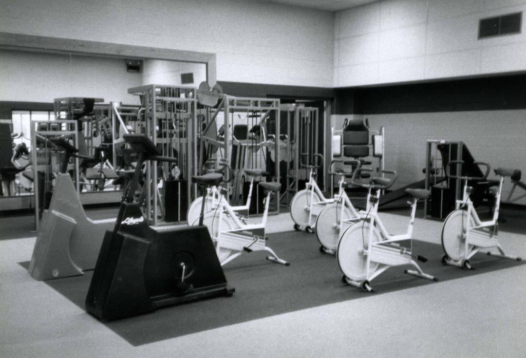 A variety of equipment awaits users in a JCC fitness room, 1986. Gift of the Jewish Community Center of Baltimore. JMM 2006.13.1994.1